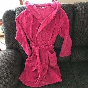 Pink, hooded, fuzzy Ulta robe. Size S/M.